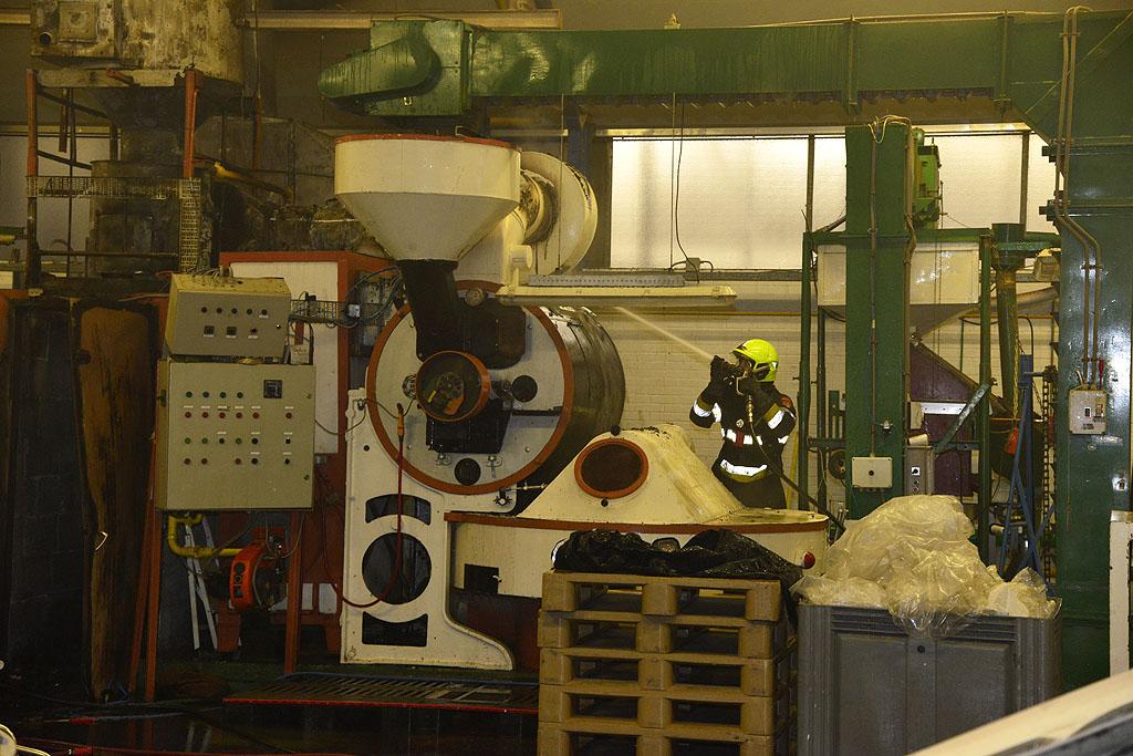 bluswerkzaamheden bij de machine © George Bakker / VRK